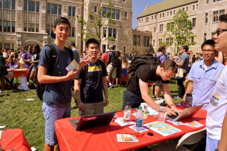 Henry Yun, left, and prospective AMA member at Student Involvement Fair on Friday, Sept. 5, 2014 in front of Stokes Hall.